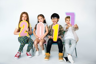 A group of young children holding a 2017 cutours