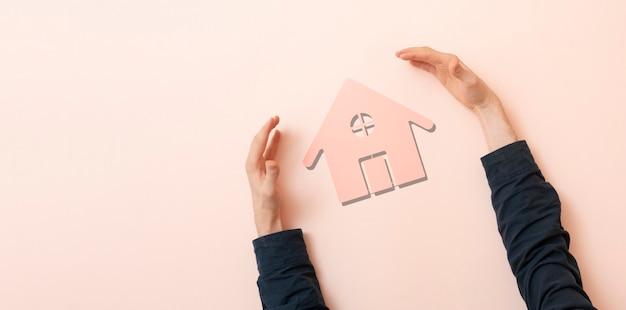 手は家のアイコン、不動産の安全性の概念を保護します