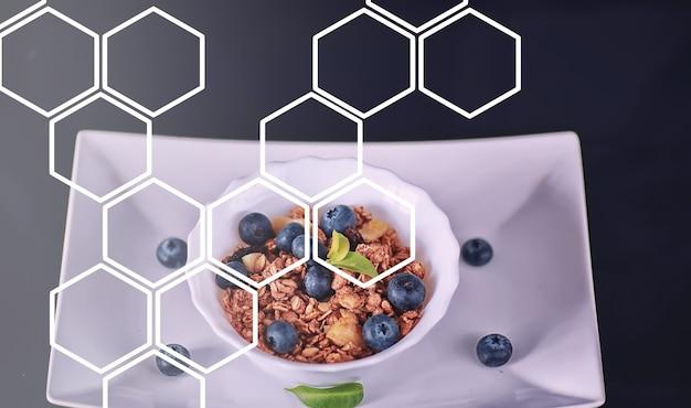 Полезные хлопья для завтрака с молоком и фруктами. овсяные и кукурузные хлопья с шоколадом и йогуртом. концепция здорового и вегетарианского питания.