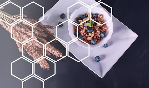 우유와 과일을 곁들인 건강한 아침 시리얼. 초콜릿과 요구르트를 곁들인 귀리와 콘플레이크. 건강하고 채식 음식의 개념입니다.