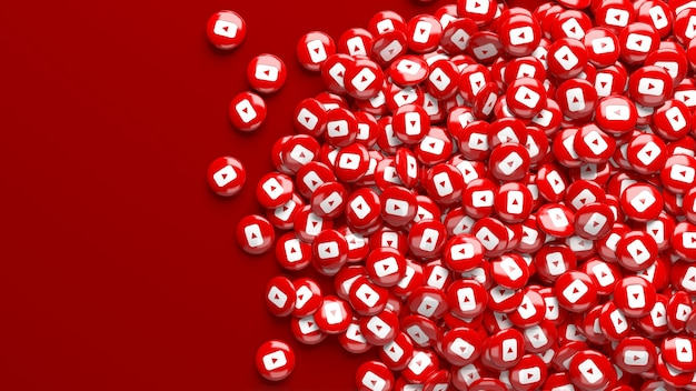 濃い赤の背景の上にたくさんの3dyoutube光沢のある丸薬
