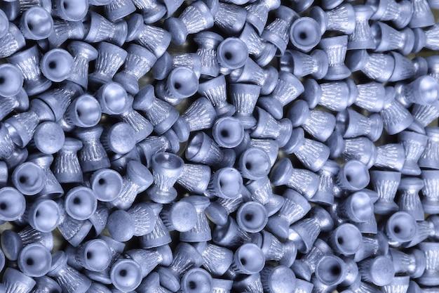 フレーム全体のエアライフル用の鉛ペレットがたくさん、クローズアップ