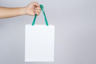 A man hand holding shopping bag