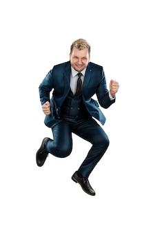 ビジネススーツを着た男、うれしそうなビジネスマンが飛び上がった
