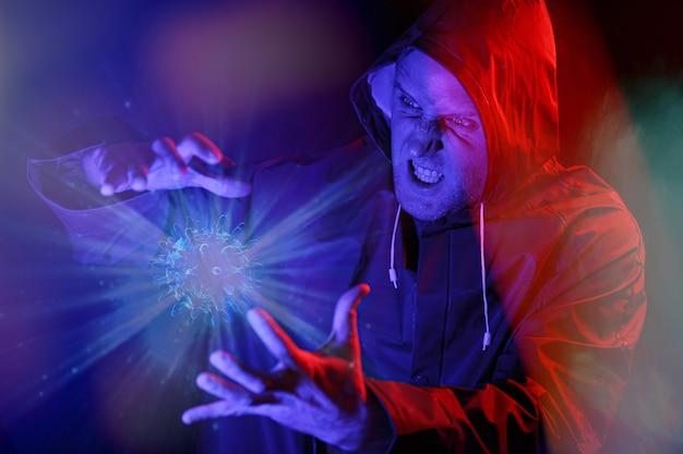 빨간색과 파란색 빛의 마스크와 화학 보호복을 입은 남자. 바이러스와 싸워라
