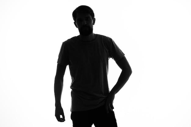 匿名スタジオの無知を手で身振りで示す影の男。高品質の写真