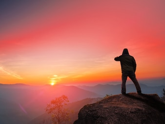 A man standing in front of beautuful sunset