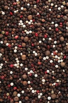Смесь перца в качестве текстурного фона в полноэкранном режиме. специи