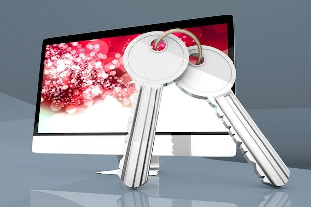 Современный компьютер «все в одном» с парой ключей, символизирующих безопасность.