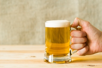 A mug of beer with foam. A glass of fresh low-alcohol beverage.