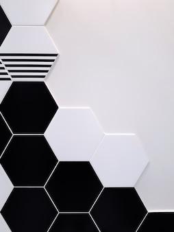 Черно-белая керамическая плитка в форме шестиугольника, который частично покрывает белую стену. концепция текстуры,