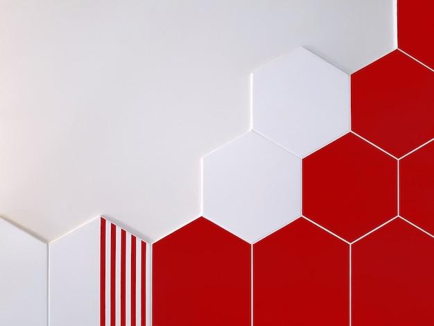 Ярко-красная и белая керамическая плитка в форме шестиугольника, который частично покрывает белую стену. концепция текстуры,