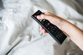 A person carrying a remote controller
