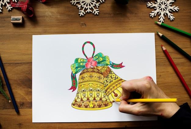 クリスマスの鐘を描く人