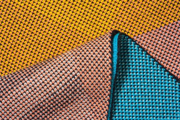 Куча разноцветного синтетического трикотажа разной текстуры и фактуры.