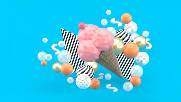 青にカラフルなボールに囲まれたピンクのアイスクリーム。 3dレンダリング。