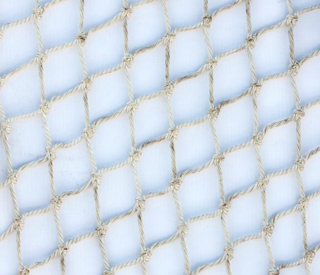 Веревочная сетка на белой подложке
