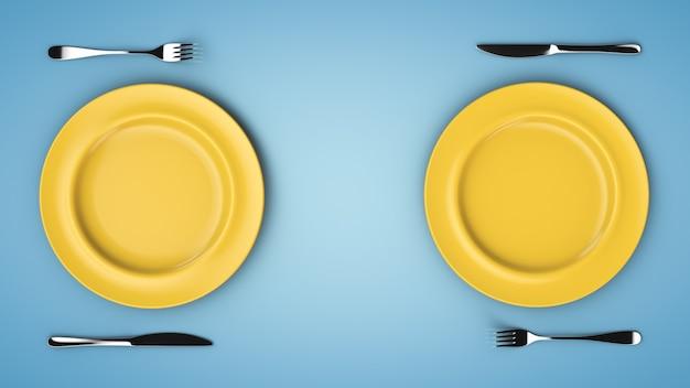 テーブルの上の2つの皿のセット。プレート、フォーク、ナイフ。