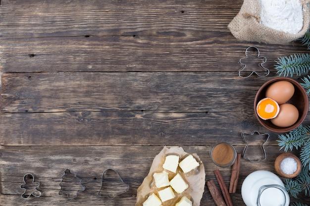 木製の背景にタルトを作るための自然製品のセット