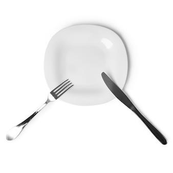 テーブルのようなアプライアンスプレート、ナイフ、フォーク、白い背景で隔離のセット