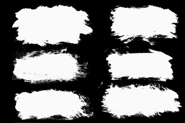黒の背景に分離された白いストロークのセット。高品質の写真