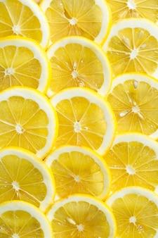 신선한 노란색 레몬 질감 배경 패턴의 조각