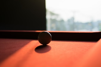 A white snooker ball on snooker table