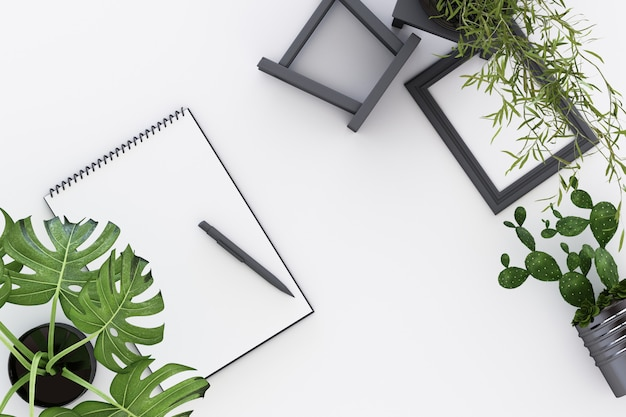 デザインコンセプト-白いa4の平面図は、黒いクリップボード鉢植え植物サボテンフレームと白い3 dレンダリングのペンで紙を裏返し