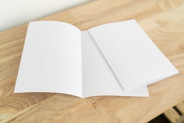 A4 fold brochures on wooden table
