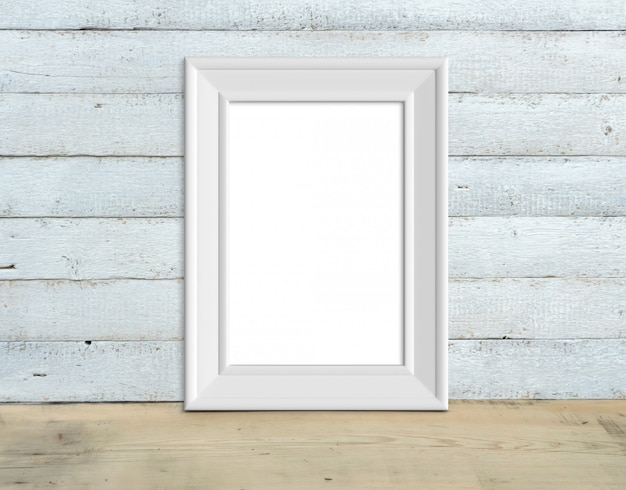 A4 vertical old white wooden frame mockup stands on a wooden table on a painted white wooden background. rustic style, simple beauty. 3d render.