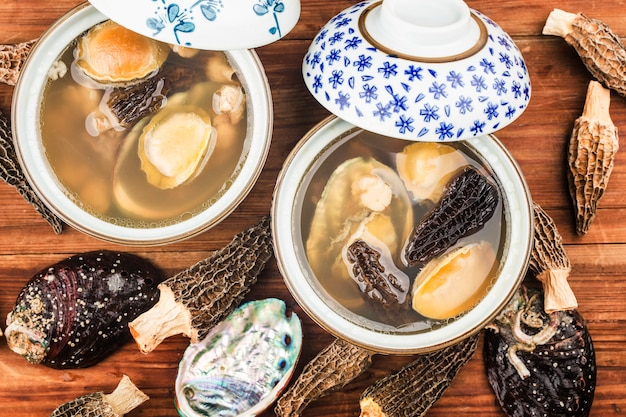 Abalone and morel chinese soup on a bowl