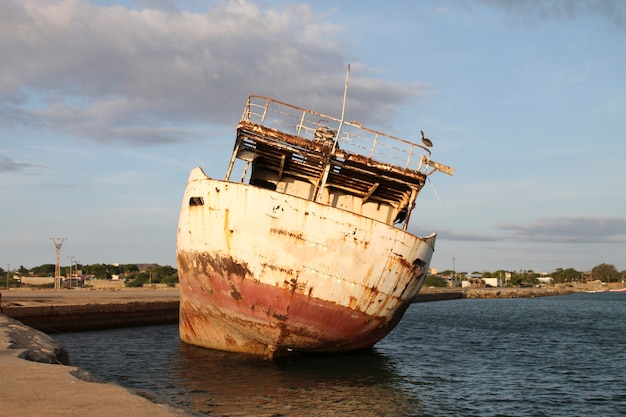 An abandoned boat on the dock