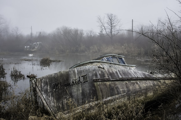 Abandoned boat on a swamp