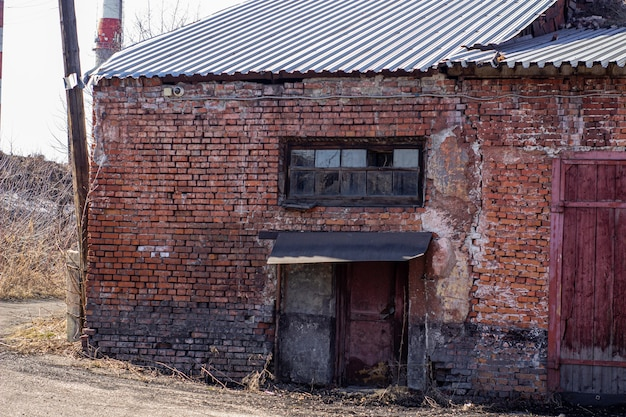 Abandoned brick building in a ruined state.