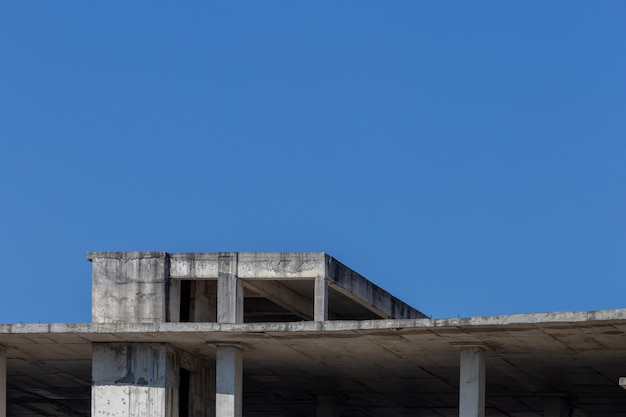 Abandoned building with blue sky for concept background