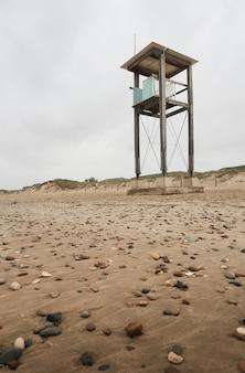 Abandoned coast guard hut on the beach