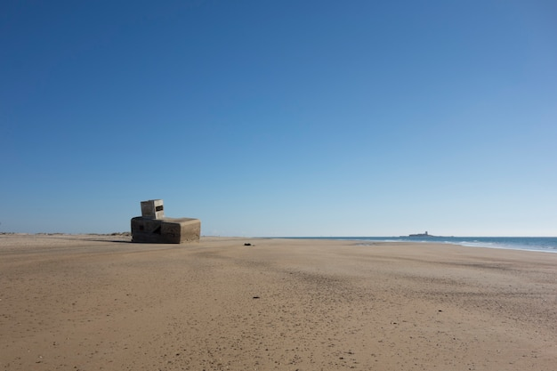 Abandoned concrete bunker on the beach