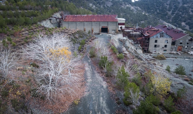 Abandoned factory buildings of asbestos mine and colorful autumn landscape of amiantos cyprus