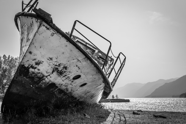 Abandoned old ship on the lake