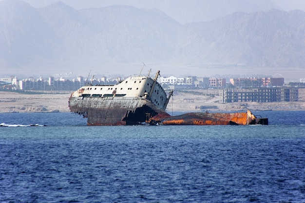 Abandoned and rusty shipwreck.