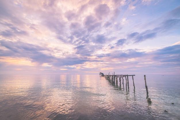 Abandoned wooden jetty at dusk, toned image