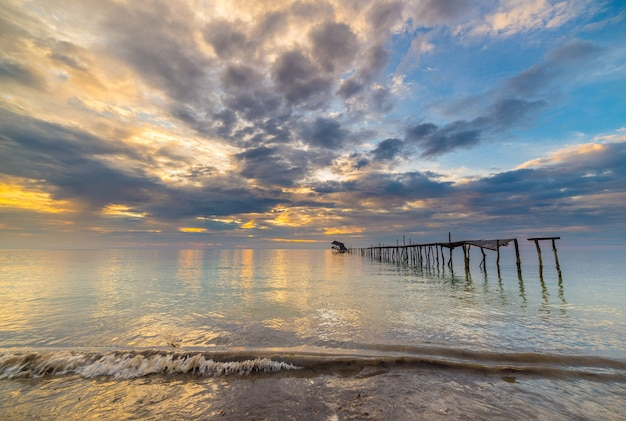 Abandoned wooden jetty at dusk