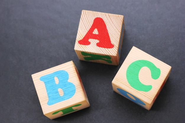 Abc -the first letters of the english alphabet on the wooden toy blocks. learn foreign languages. english for beginners.