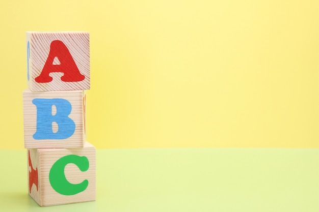 Abc -the first letters of the english alphabet on wooden toy cubes.
