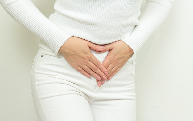 Abdominal pain of young woman, gynecological or medical problems concept