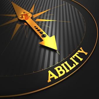 Концепция способности - золотая стрелка компаса на черном поле.