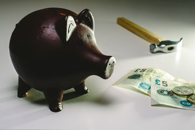 About to break piggy bank with english money to face savings in times of economic crisis.