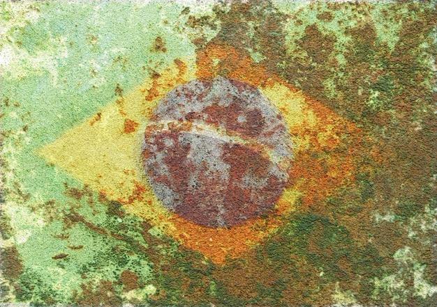 カビの生えた、さびたテクスチャ表面のブラジル国旗の抽象的な3d背景