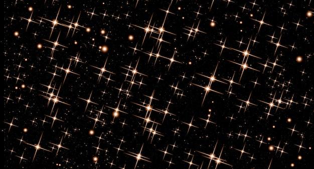검은 배경에 황금 별의 밝은 반짝이와 추상 추상 크리스마스 배경