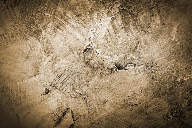 금이 간 페인트 돌 질감이 있는 오래된 갈색 벽의 추상 추상 그런지 배경